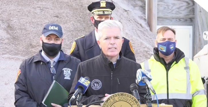Suffolk County Executive Steve Bellone (center, front) announces the County's effort to prepare for the upcoming snow storm at a press conference Tuesday, Dec. 15 at the Suffolk County Department of Public Works yard salt barn in Commack.