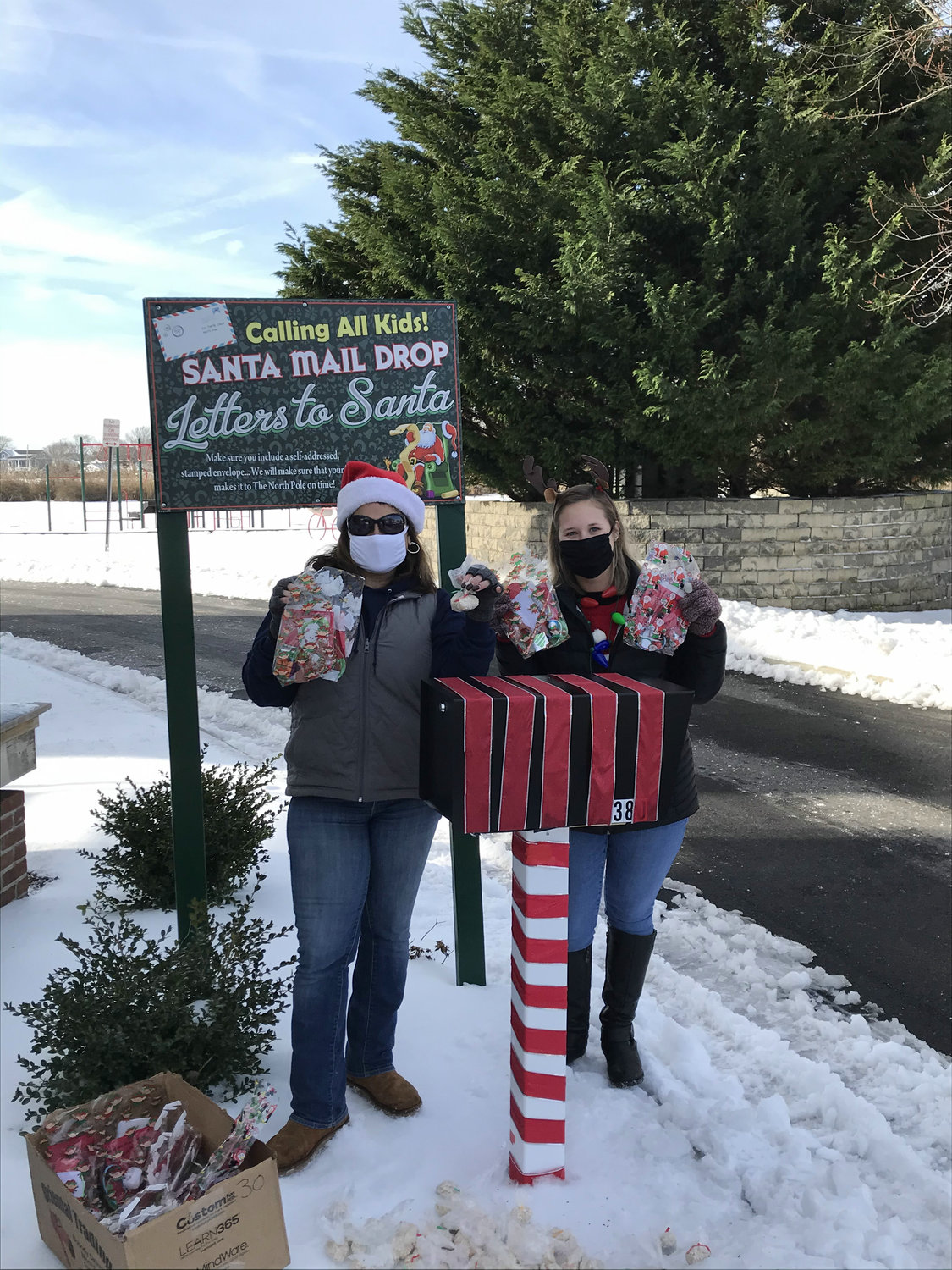 Parks director Maria Giustizia and her Christmas helper Ashley Blydenburg served treat bags to over 20 cars last Saturday, ahead of the holiday.