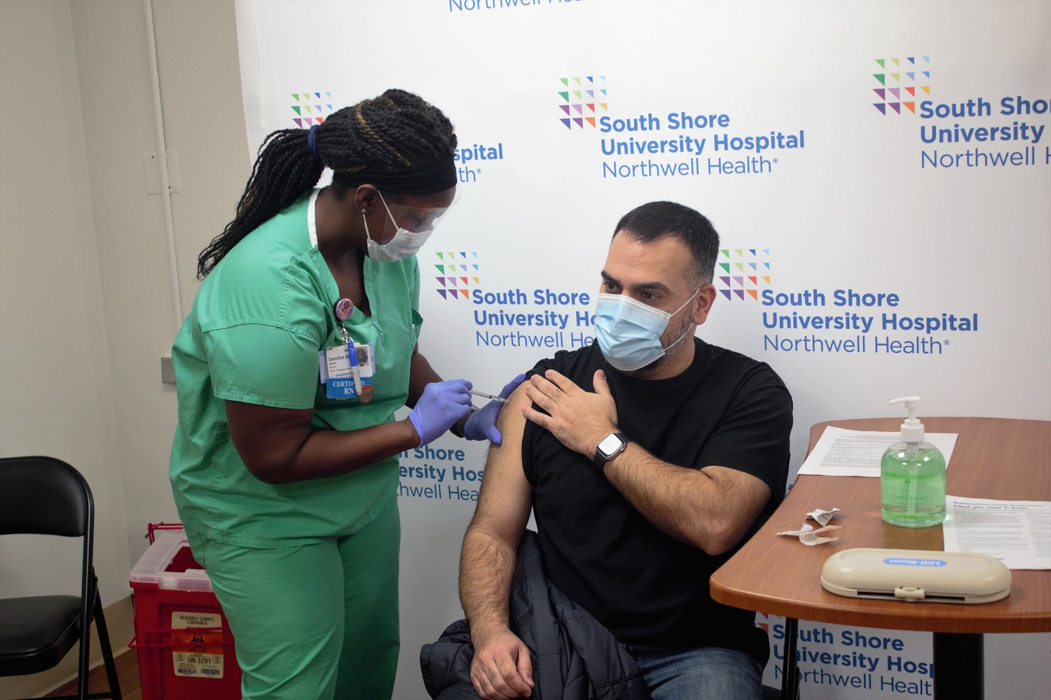 Matthew Rivera, 45, of Bay Shore, receives the first dose of the COVID-19 vaccine Tuesday, Dec. 15.