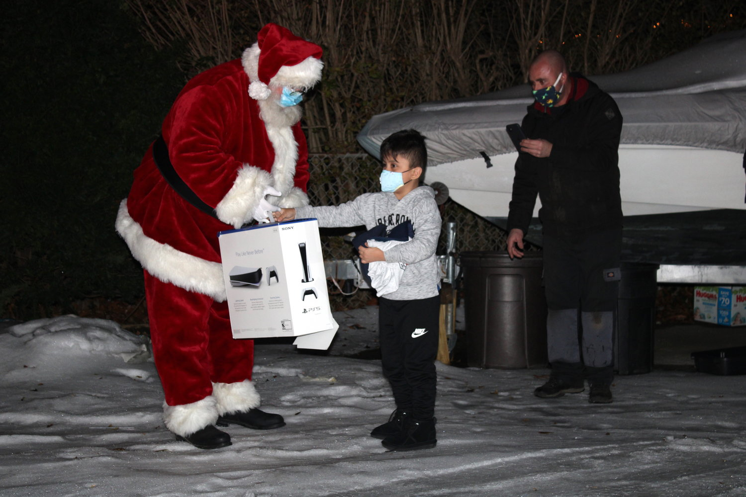 Joshua, who has cancer of the lymph tissue, had his Christmas wish granted by the Make-A-Wish Foundation Dec. 23 with help from the Mastic Beach and Mastic fire departments, the Brookhaven Fire Department, Mastic Beach Ambulance and Santa Claus.
