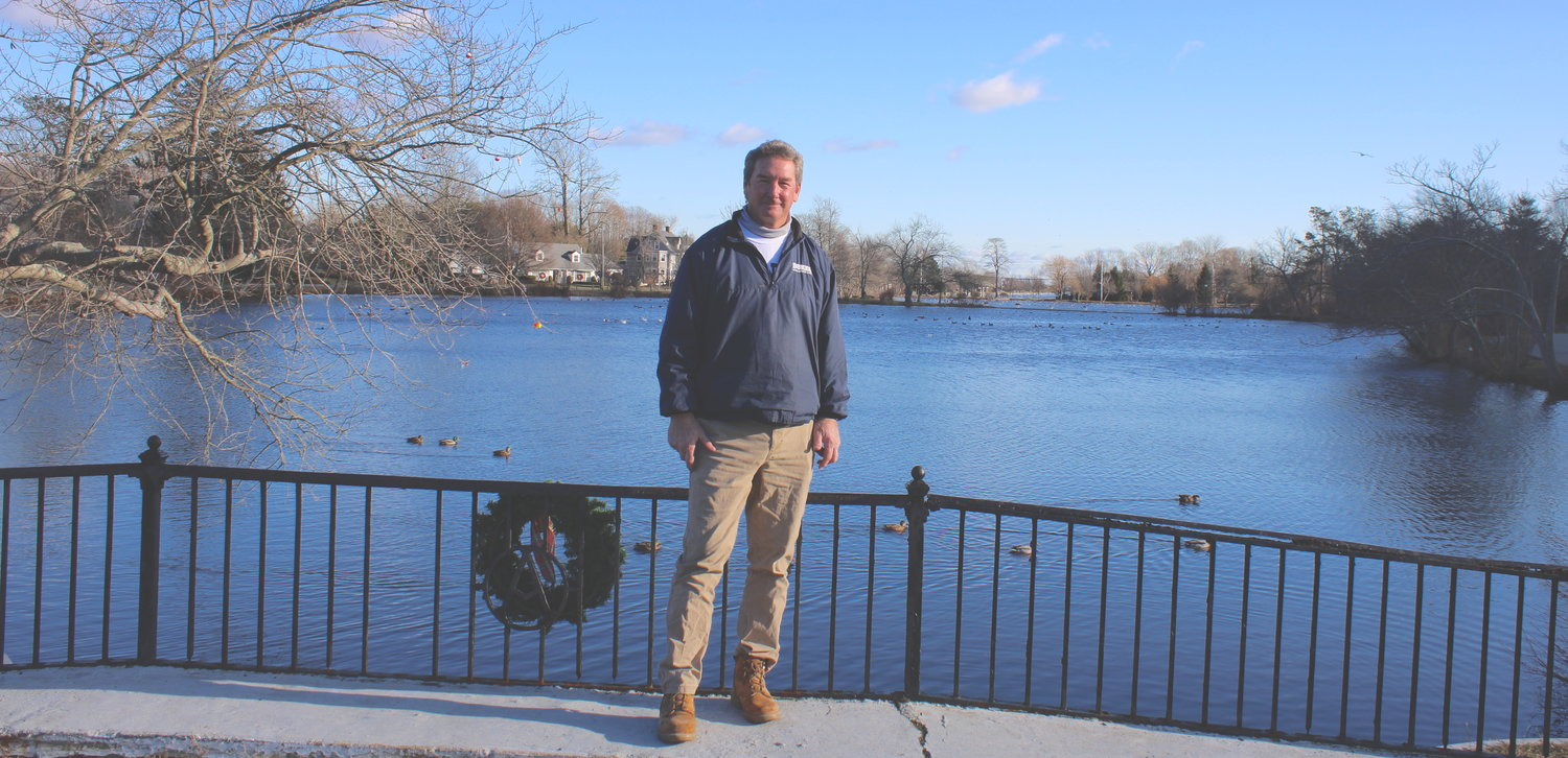 Brightwaters Village mayor John Valdini stands beside the village lakes on Monday, Jan. 4. Numerous infrastructure changes are planned in the village for 2021.