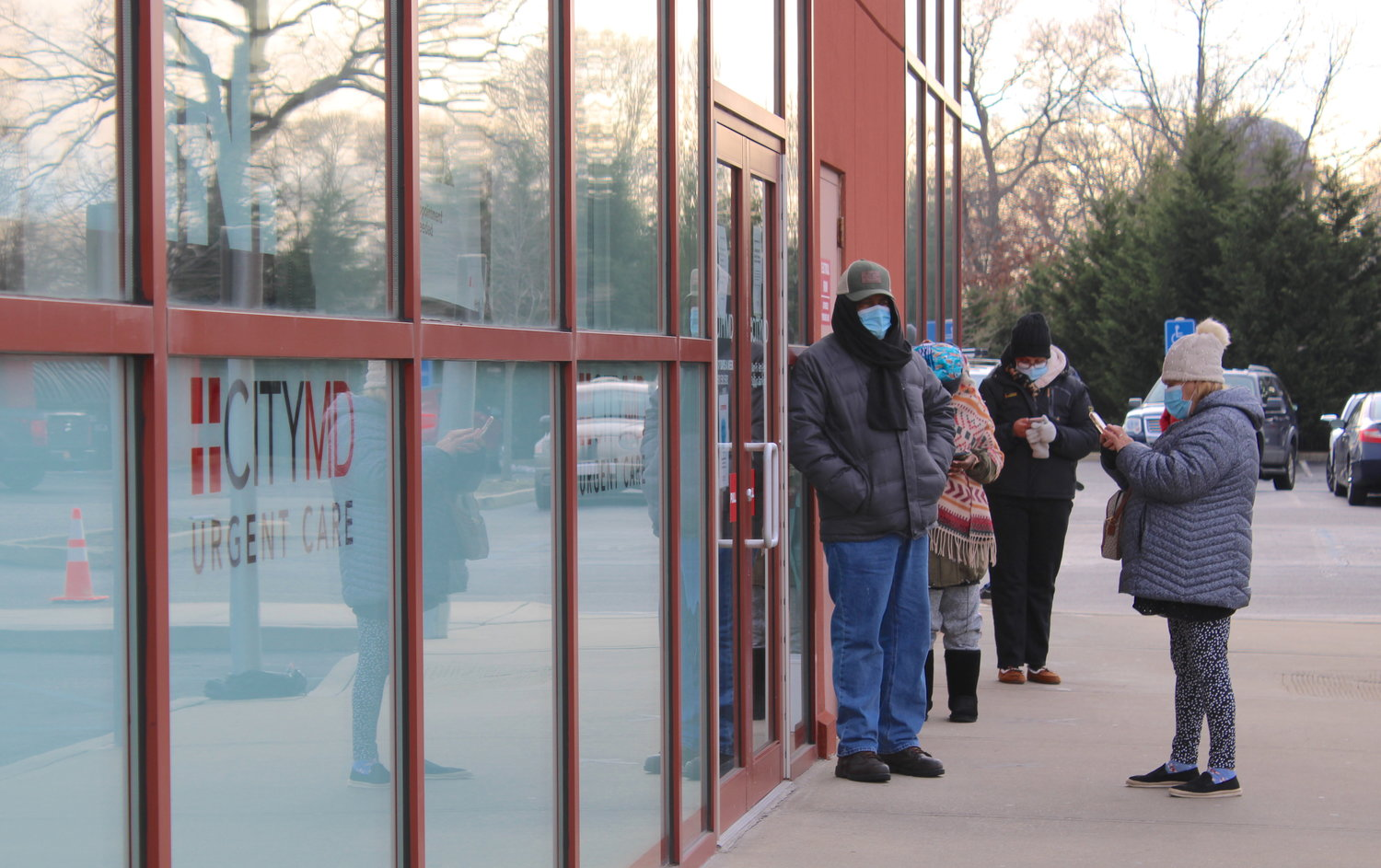 Community members wait in line outside CityMD South Bay Shore Urgent Care on Monday, Jan. 11.
