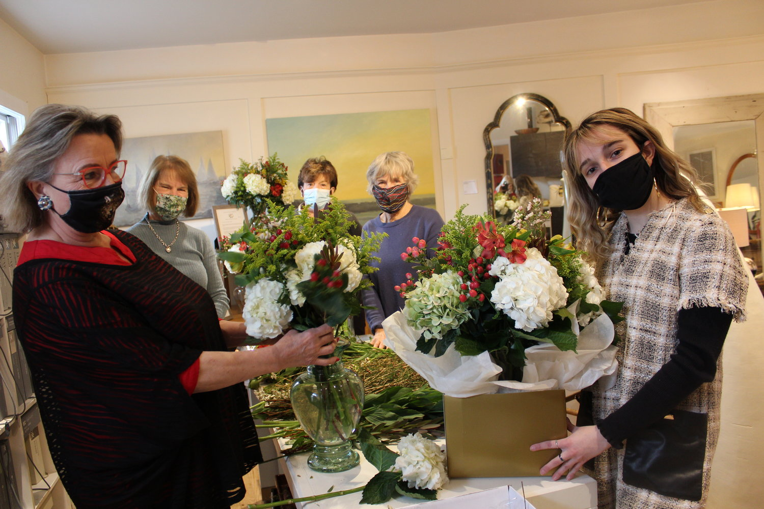 The South Country Education Foundation Inc. sponsored bouquets for teachers in seven local schools this week. Left to right: SCEF board member Pamela Lerner, SCEF vice president Diane Zanazzi, SCEF president Robin Roe, Bellport Garden Club civic chair Jane Tierney and Pamela Lerner Home & Design staffer Sam Mayo. Lerner and Tierney did the arrangements.