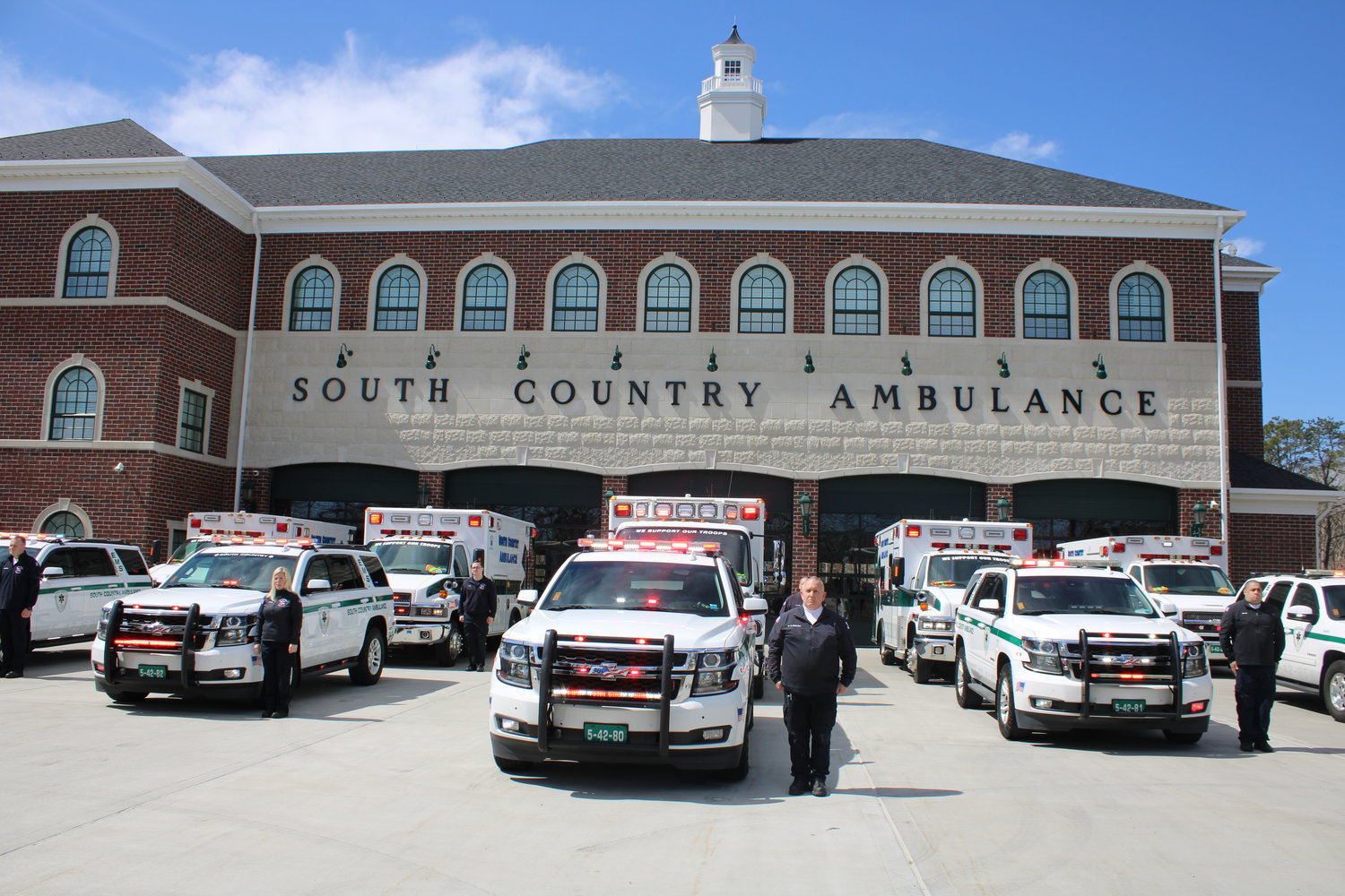 Brookhaven and Islip Town first responders switched on emergency vehicle lights at noon on April 7 at the South Country Ambulance station