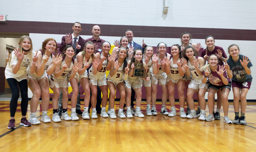 Strafford players hold up six fingers signifying their postseason success following last Thursday's Class 3 district championship win over Sparta in Mansfield.