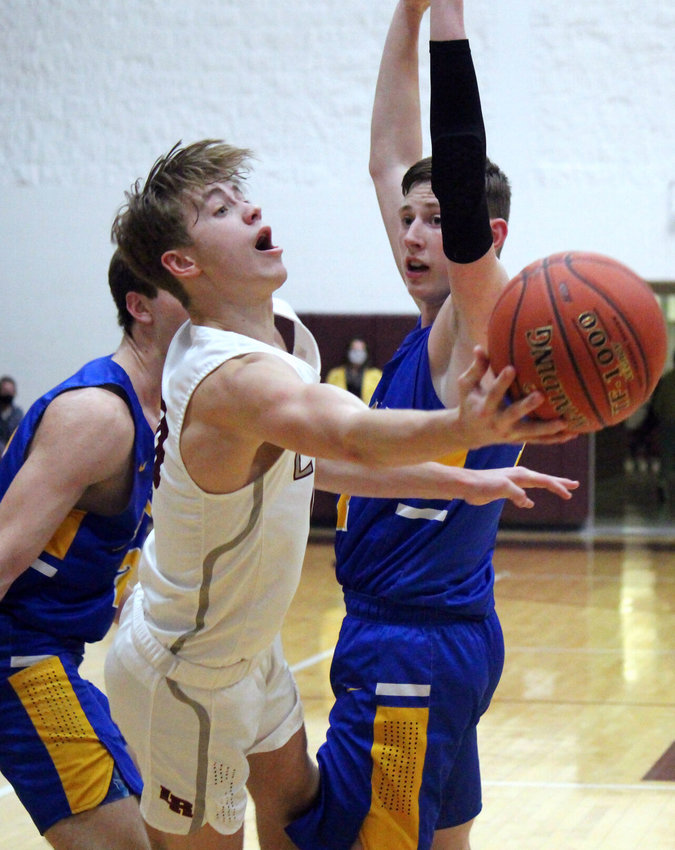 Kanon Gipson pirouettes between two Bolivar defenders to get a shot off in the victory Friday night.