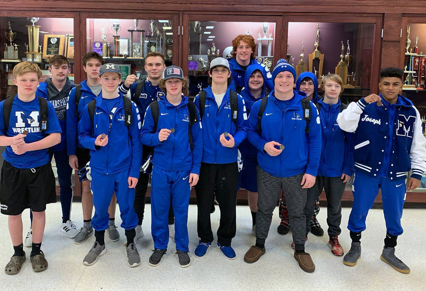 Marshfield wrestlers show off their medals earned following the action in Camdenton. The 11 who advanced from Camdenton will compete at sectionals later in the month for an opportunity to advance to the state tournament.