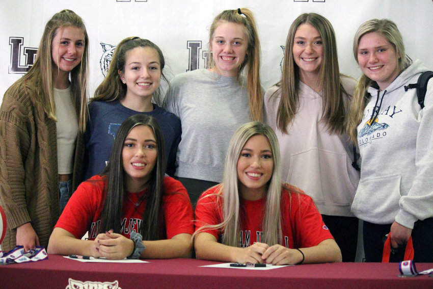 McKinzie and Samantha Thompson, headed to play at William Jewell College, enjoy a picture with teammates at Logan-Rogersville's signing day ceremony on Nov. 12.