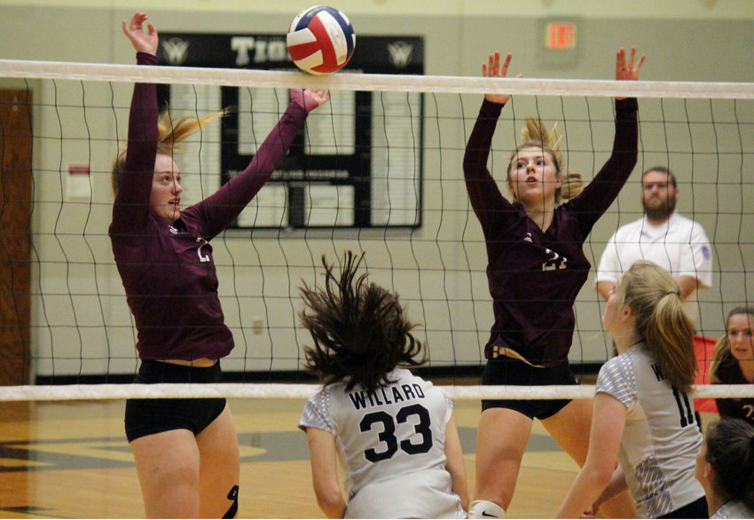 Logan-Rogersville senior Chelsea Schatzer (left) and sophomore Olivia Frieze deny Willard a point at the net in the district title game against Willard.