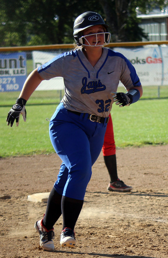 A nearly one-eyed Kirsten Ward circles third base following her home run in Marshfield's district game against West Plains on Oct. 13. Ward was selected second-team All-Big 8.