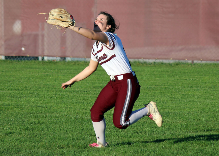 Logan-Rogersville right fielder Jessi Jenkins charges in to make a catch in Thursday evening's Class 3 state quarterfinal against Sullivan.