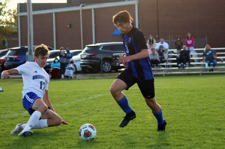 Marshfield sophomore Connor Bixler retains the ball despite a sliding challenge late in the Jays' defeat to Greenwood on Sept. 29.