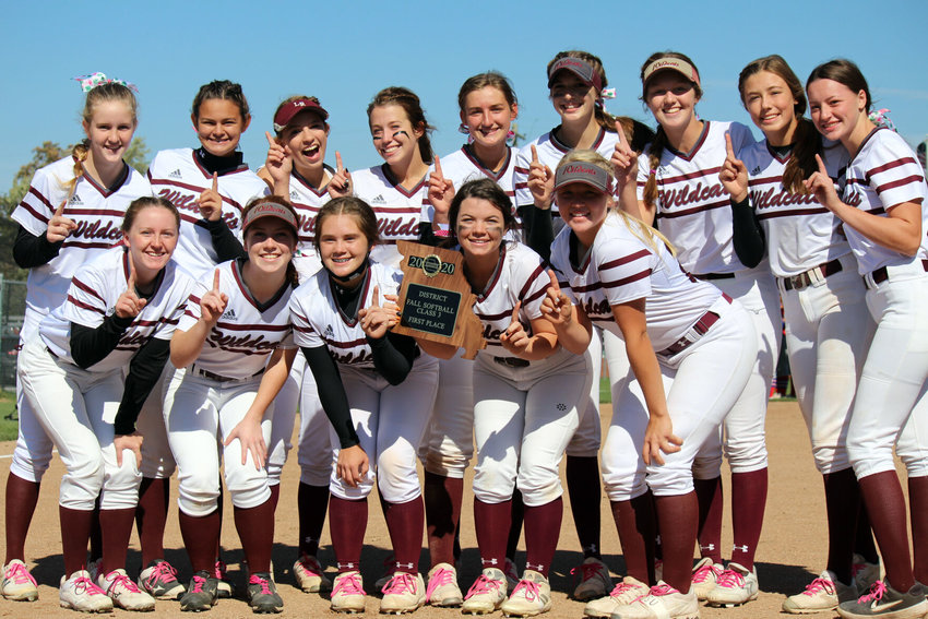 Logan-Rogersville players pose with the first-place district trophy after Saturday afternoon's 16-1 victory over Seneca.