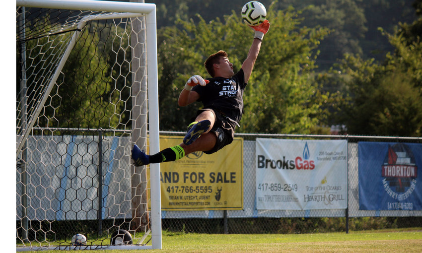 Junior goalkeeper Mathew Derecichei shows off his shot-stopping abilities at the end of Monday afternoon's practice.