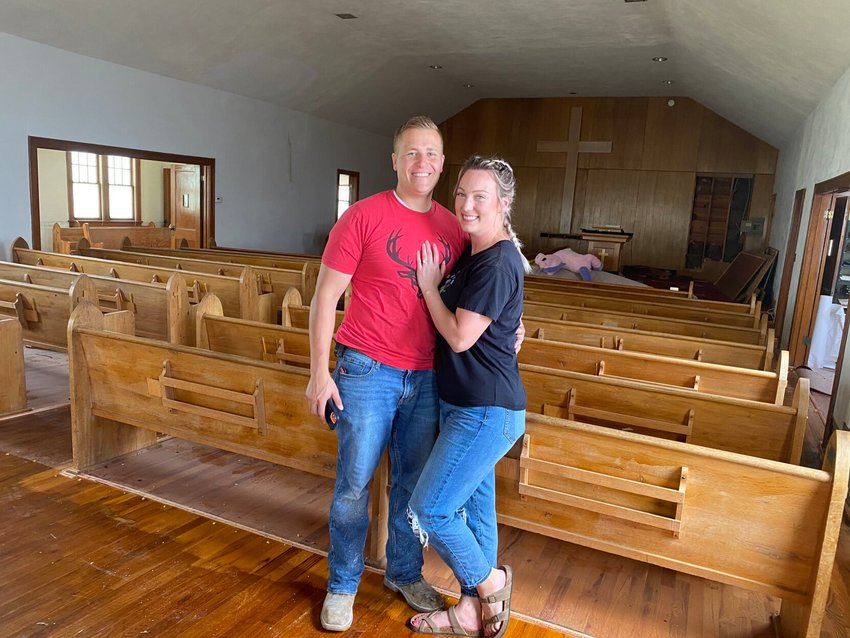 Josh Morley (left) and Danae Wheeler (right) pictured in the sanctuary of their new home. The couple plans to leave the sanctuary as a sanctuary space which will double as a formal living room. Sharing the upper level of the home will be the kids' bedrooms and a master bedroom with a bathroom.