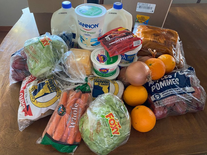 Each Farmers to Families box is filled with fresh produce, dairy and meat for families to prepare. This weeks boxes contained a variety of items including chicken wings, hot dogs, lettuce, potatoes, carrots, apples, yogurt, cottage cheese, milk and American cheese slices.