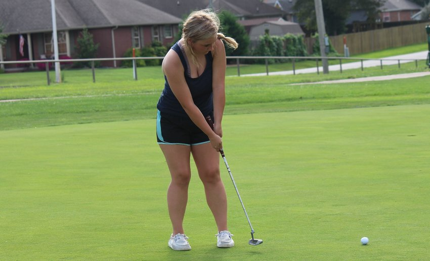 Senior Brianna Henderson putts as part of a game to close out a Marshfield practice last week at Whispering Oaks.
