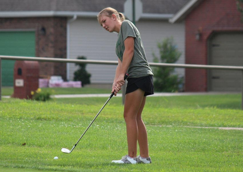 Marshfield sophomore Marlee Edgeman chips onto the green at practice at Whispering Oaks Golf Course, where she shot a 142 as the best score at the course's club championship recently.