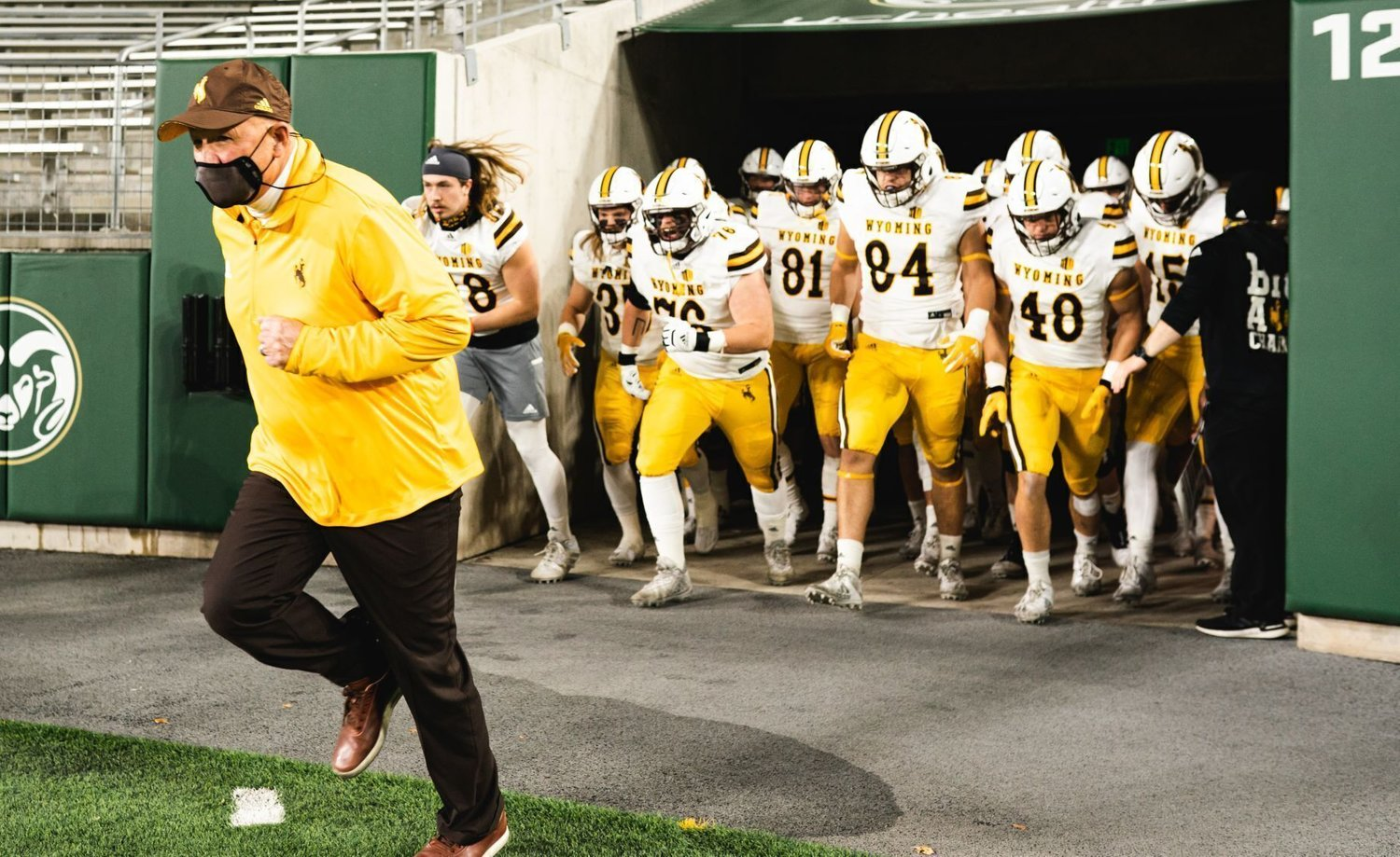 Wyoming coach Craig Bohl leads his players onto the field before the Cowboys' game against Colorado State on Nov. 5, 2020, at Canvas Stadium in Fort Collins, Colo.