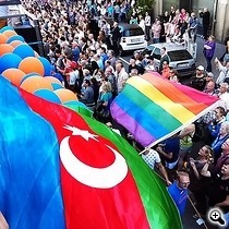 An Azerbaijani flag at an LGBT pride parade in Germany in 2015. Police have reportedly arrested more than 100 gay Azerbaijanis over the past days.