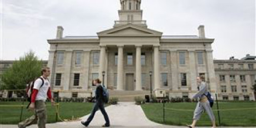 University of Iowa students walk past the Old Capitol building in Iowa City.