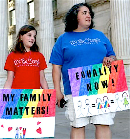 Nine-year-old Lillian Gutierrez, left, joins her mother, Veronica, both of Denver, in waving placards at a protest outside the Federal Courthouse in downtown Denver on April 9, 2014. The protest, sponsored by Support Marriage Equality in Colorado, was held as a federal appeals court weighs inside the Denver courthouse whether to give an important victory to gay couples' right to marry in Utah and Oklahoma.