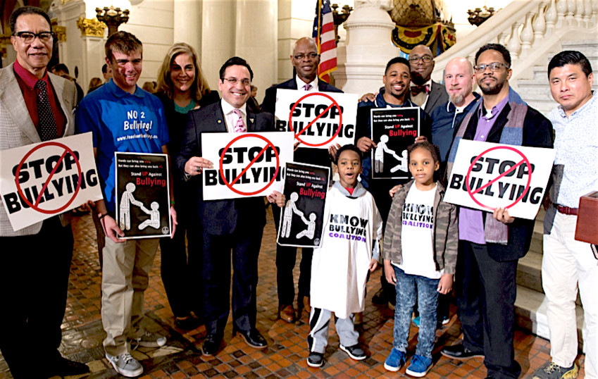 Surrounded by parents, advocates and legislators in the state Capitol, state Rep. Stephen Kinsey, D-Phila., center, sounded the call to bring an end to bullying in Pennsylvania schools and communities
