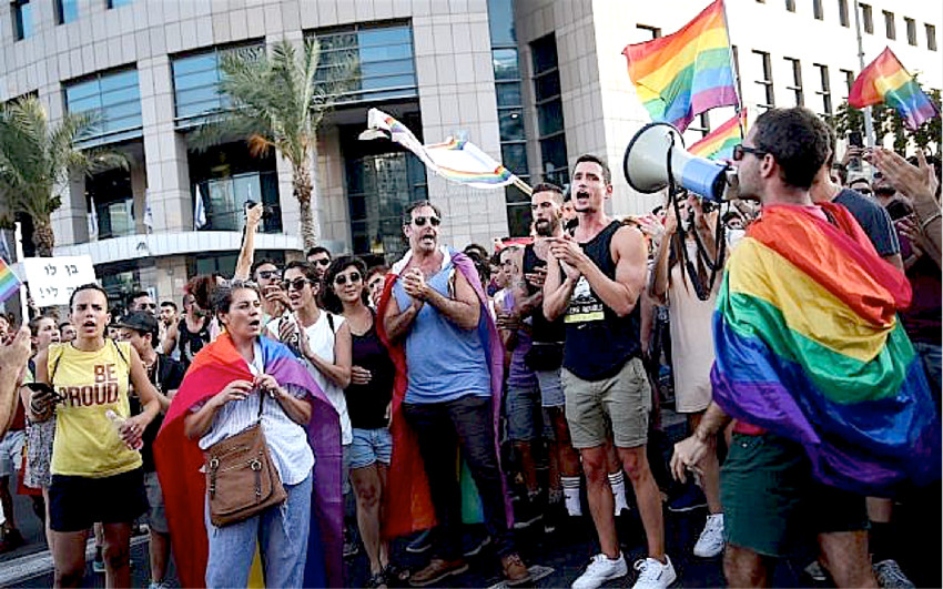 Members of the LGBT community demonstrate in Tel Aviv against a Knesset legislation that denies surrogacy rights for same-sex couples on July 18, 2018.