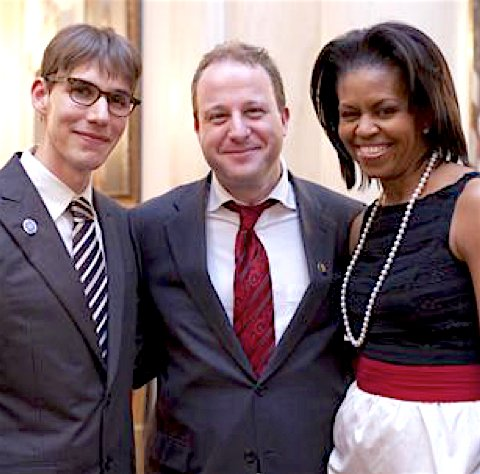 Rep. Jared Polis (center) with his partner, Marlon Reis (left), and First Lady Michelle Obama at the White House.