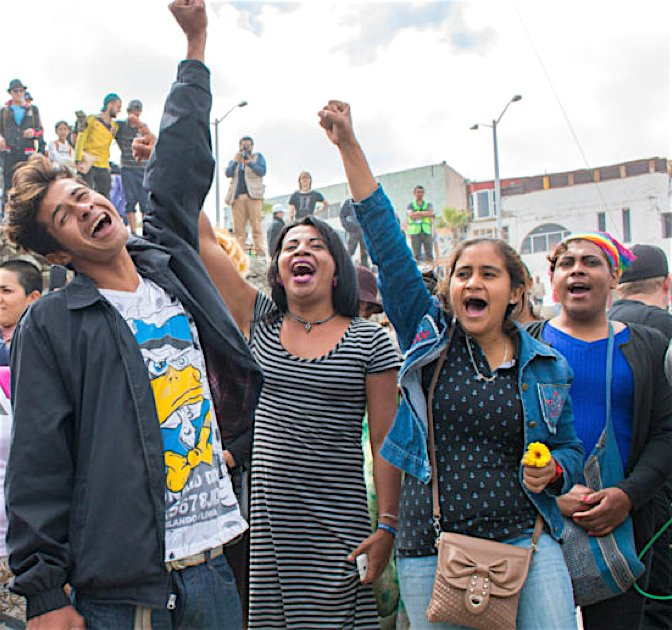 Migrants, advocates and other participants at a rally in Playas de Tijuana sang and chanted along to Jimmy Golden's caravan song in April 2018.