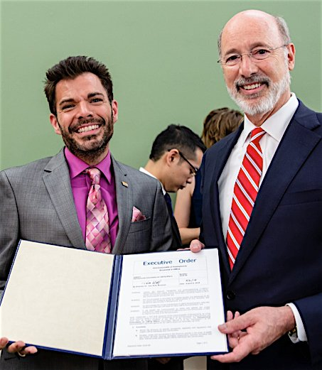 Todd Snovel, left, with PA Gov. Tom Wolf with the Executive Order establishing the Pennsylvania LGBTQ Commission. Snovel is the commission's executive director.