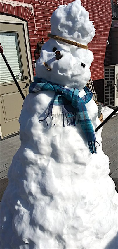 With warmer temperatures and Daylight Savings time upon us, a melting snowman calls out for help from a second story deck in Harrisburg.