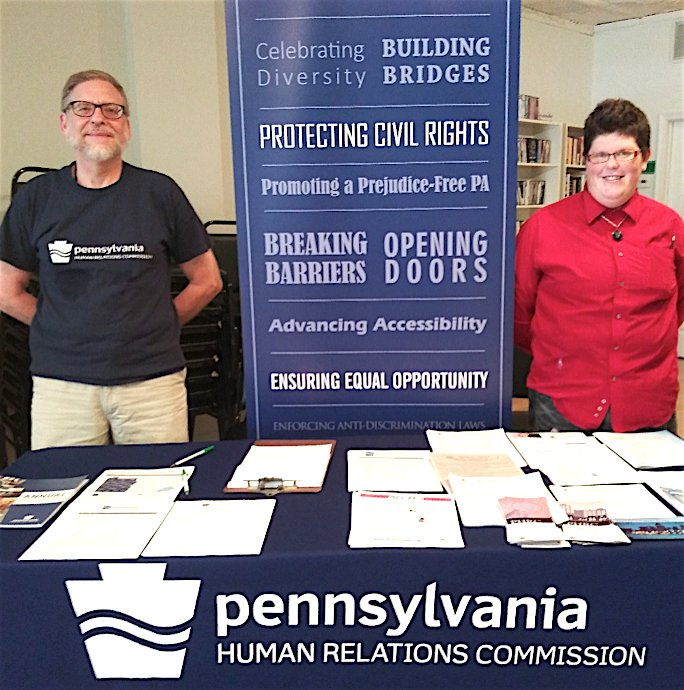 Pennsylvania Human Relations Commission staff member Keith Yundt, left, and volunteer Killian Brady, right, hosted a 2-hour walk-in session Aug. 3 at the LGBT Center of Central PA.