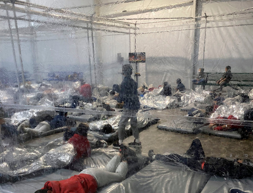 This March 20, 2021, photo provided by the Office of Rep. Henry Cuellar, D-Texas, shows detainees in a Customs and Border Protection (CBP) temporary overflow facility in Donna, Texas. President Joe Biden's administration faces mounting criticism for refusing to allow outside observers into facilities where it is detaining thousands of immigrant children.