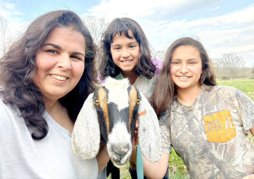RUSTIC WATERS FARM is owned and operated by the Montalvo family, including mom Miriam and daughters Faith and Annalise.