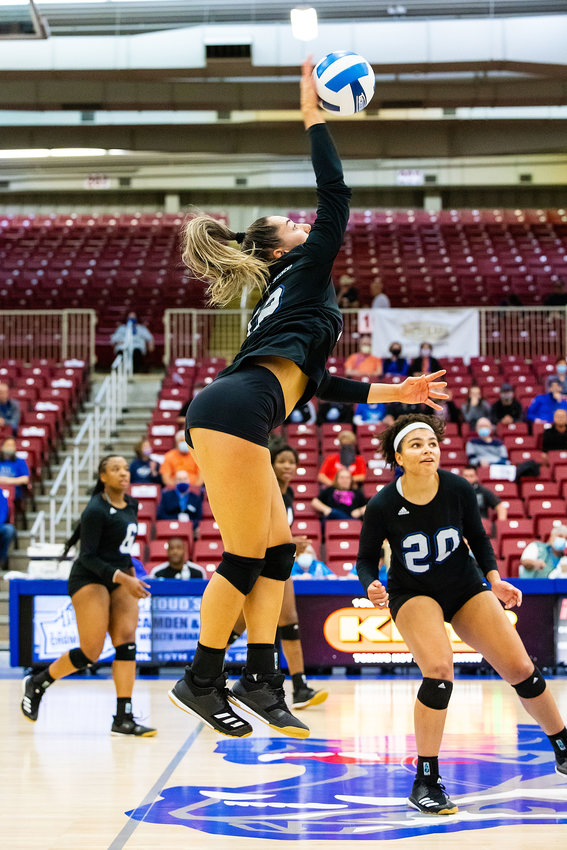 MAJU LOUREIRO, an outside attacker on the Missouri State University-West Plains Grizzly Volleyball team, has been named first team NJCAA All-American. Here, she goes for a kill during the ninth-place game at the recent NJCAA Division I National Volleyball Championship Tournament at the West Plains Civic Center.