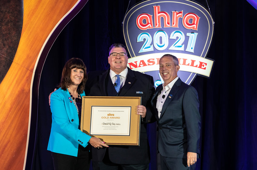 David R. Fox,BaxterRegionalVP/COO, accepted the AHRA Gold Award from Jacqui Rose, AHRA President, and Jason Newmark, 2020 AHRA Gold Award recipient, at an awards ceremony at the AHRA 49th Annual Meeting and Expo on Monday, August 2.