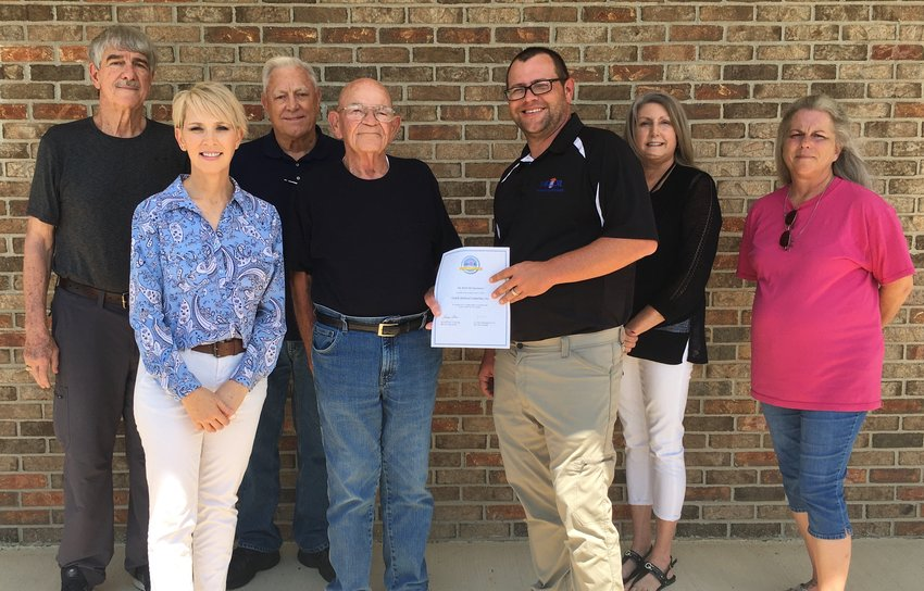 OZARK SHELTERED INDUSTRIES, INC. is grateful to receive a grant from the MFA Oil Foundation which will help to light their location. From left: Davis Raush, OSI Board Member; Kimberly Hoopes, OSI Director; Clarence Barber, OSI Board Vice President; Leon Thompson, OSI Board President; Matthew Warren, Manager at MFA Oil; Jennifer Strange, OSI Board Member; Kelli Neel, OSI Board Member. Not pictured: Patricia Wilhelm, OSI Board Member, and Ariane Brooks, OSI Board Member.