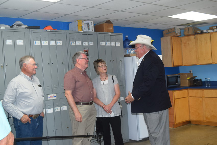 REPRESENTATIVE BILLY LONG speaks with community members at the Meet and  Greet hosted at Hirsch Farm and Feed in West Plains. Pictured left to right Mark Collins, Howell County Commissioner, Howell County Collector, Dennis K. Von Allmen and wife Judy and Representative Long.