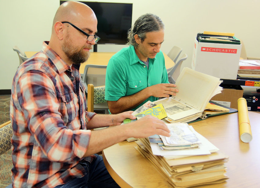 MISSOURI STATE UNIVERSITY-WEST PLAINS (MSU-WP) faculty members Frank Priest, left, and Dr. Jason McCollom look through old brochures and newspaper clippings to determine if they meet the criteria for inclusion in the new Ozarks Heritage Resource Center at the Garnett Library.