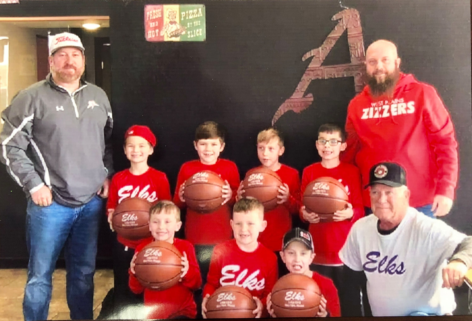 THE WEST PLAINS Elks Lodge 2418 Past Exalted Rulers Association recently sponsored a pizza party for the West Plains Shooter basketball team at Pizza Shack where they presented each player with a new basketball. The party was to celebrate the team winning the first grade division and being undefeated in the Mtn. View K-1 Leage. Front row, from left: Kreed Gunter, Sawyer Trail, Kasen Brown, and past Exalted Ruler Craig Jordan. Second row: Elk Jason Jordan, Reed Jordan, Cash Tidwell, Judd Hayes, Jarret Renfrow, and Coach Justin Brown.