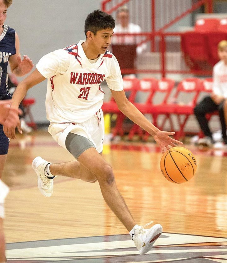 Hector Quinonez hustles the ball down the floor for Washington. The Warriors open the State Playoffs Friday and host Star Spencer. The girls tip off at 6 p.m. and the boys play at 8 p.m.