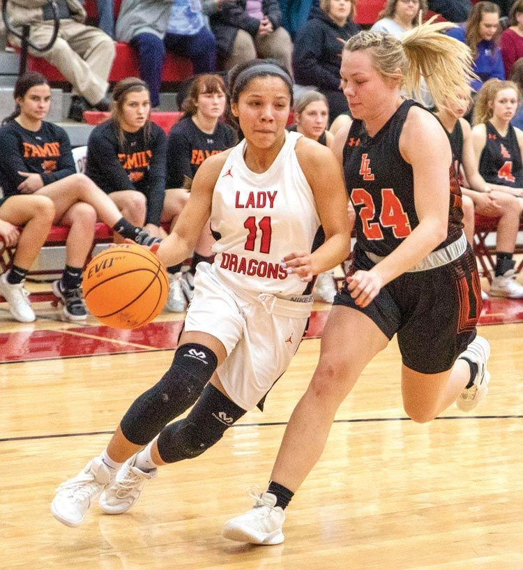 Chelsea Spain dribbles towards the lane during Purcell's 48-27 win over Lindsay last Tuesday. Purcell hosts Marietta Saturday in the District tournament. Tip off is set for 6:30 p.m.