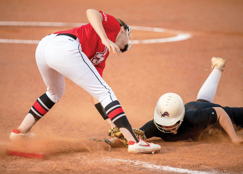 Washington sophomore Emjay Lucas tags a Blanchard base runner Monday. The Warriors lost to the Lions 6-3.