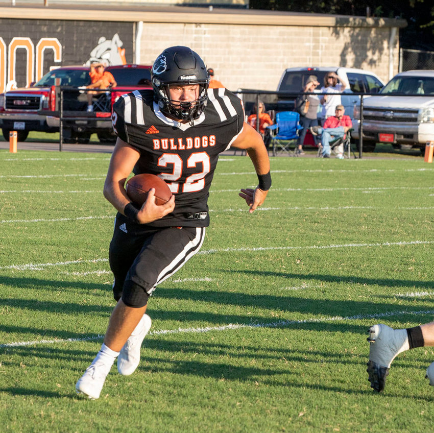 Wayne senior Brannon Lewelling runs with the ball at D.S. Zack Powell Stadium. Lewelling rushed for 86 yards on eight carries in Wayne's 48-16 win over Walters Friday night.