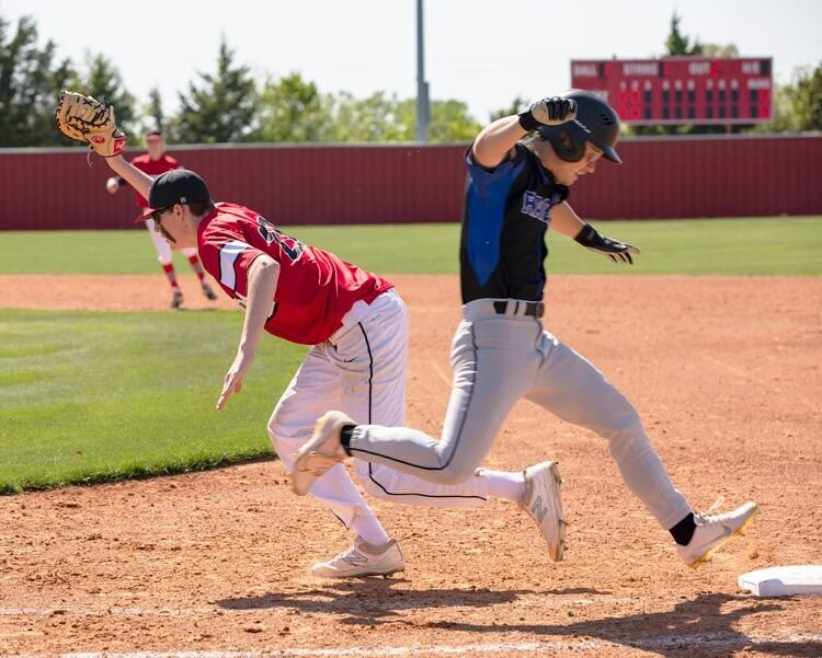 Purcell senior Jayden Payne shows the ball after catching it for an out at first base during the District tournament. The Dragons lost the first game to Newcastle 4-2, won the second 3-2 and lost the third game 9-5.