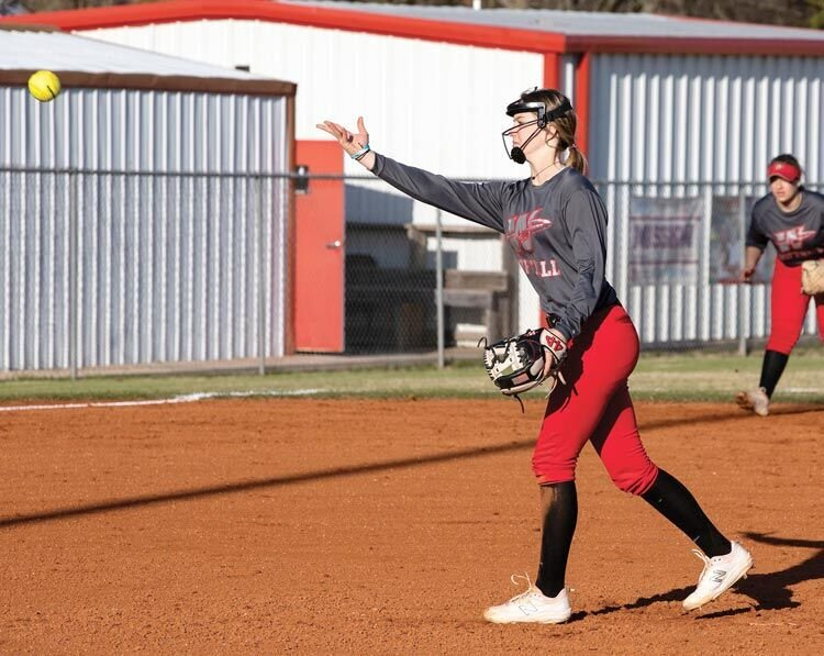 Washington sophomore Tinley Lucas lets a pitch fly for the Warriors. Lucas and company play host beginning today (Thursday) at the Washington Invitational Softball Tournament.