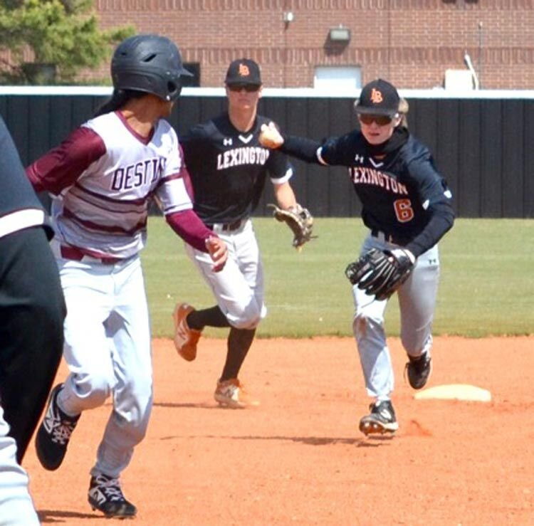 Lexington sophomore Corbin Perry chases back a Destiny Christian base runner at the wooden bat tournament in Newcastle. Lexington was defeated 16-0.