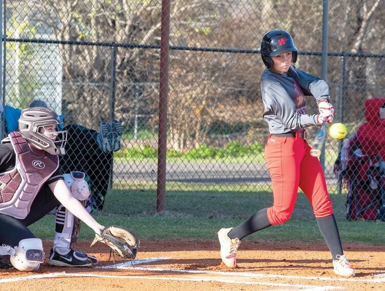 Washington junior Kaydence Andrews squares up a pitch during the Warriors' 11-1 win over Blanchard. Washington travels to Weatherford for the Best of the West Tournament Thursday.