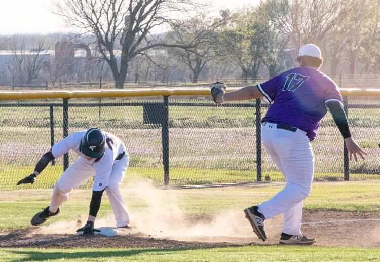 Wayne junior Braxton Smith reaches third base ahead of the throw Monday evening during Wayne's five-inning game against Elmore City. The Bulldogs were defeated 11-1.